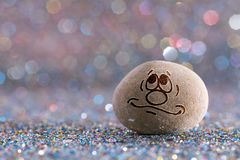 The dream stone emoji. Emotions on color glitter boke background stock photo