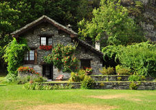 Dream stone house and garden in the Italian Alps Stock Images