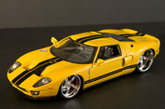 Dream supercar. Picture of a miniature replica of a toy car Royalty Free Stock Photo