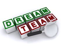 Dream team. Graphic in block text on white blocks with magnifying glass on white background royalty free stock image
