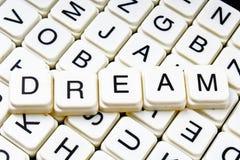 Dream text word crossword. Alphabet letter blocks game texture background. Stock Photo