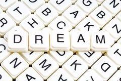 Dream text word crossword title caption label cover background. Alphabet letter toy blocks. White alphabetical letters. Dream stock photos