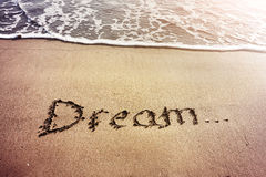 Dream title on the sand. Beach near the ocean royalty free stock images