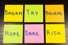 Dream try believe hope dare risk sticky note on wooden background Royalty Free Stock Image