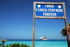 Dream Vacation. The view of a sign with a dream wish and the cruise liner in a background on little tropical island Half Moon Cay, The Bahamas Royalty Free Stock Images