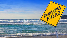 Dream vacation ahead. Road sign with dream vacation ahead stock image