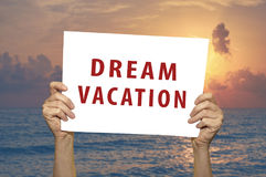 Dream Vacation card with a sea on background