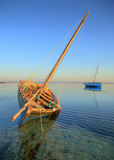Dream vacation isalnd dhow boat. Beautiful dhow or traditional fishing sailing boat in the water at the island on a dream summer vacation or holiday Stock Photography