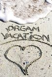 Dream vacation phrase handwritten on the sandy beach Stock Photo