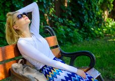 Dream vacation. Woman blonde with sunglasses dream about vacation, take break relaxing in park. Girl sit bench relaxing stock photos