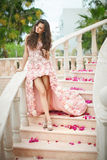 Dream wedding, beautiful bride, walking down stairs with flowers Stock Image
