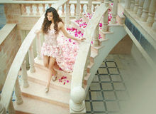 Dream wedding, beautiful bride, walking down stairs with flowers Stock Photos
