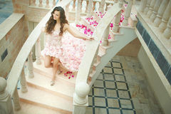 Dream wedding, beautiful bride, walking down stairs with flowers Stock Photography