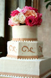 Dream Wedding Cake. This wedding cake topped with roses would be a dream wedding cake for any bride Stock Photography