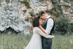 Dream wedding in mountains. A dream wedding in the mountains. The Ural mountains and river, beautiful paisaje and wedding at sunset. The exit sign with arch royalty free stock images