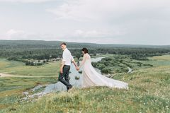 Dream wedding in mountains. A dream wedding in the mountains. The Ural mountains and river, beautiful paisaje and wedding at sunset. The exit sign with arch stock photo