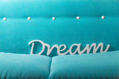 Dream white letters on a blue green soft textile background Royalty Free Stock Photography