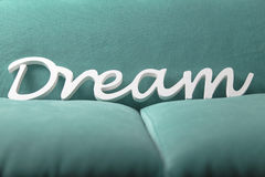 Dream white letters on a blue green soft textile background Royalty Free Stock Images