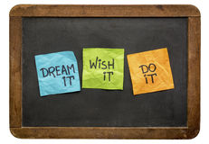 Dream, wish and do it on sticky notes. Dream it. Wish it. Do it. Motivational concept - handwriting on sticky notes against vintage slate blackboard Royalty Free Stock Photography