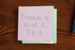 Dream it wish it do it written on note Stock Photos