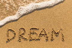 Dream - word drawn on the sand beach Royalty Free Stock Image