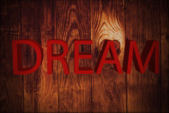 Dream. Word dream isolated in vintage wood Stock Photos