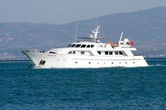 Dream yacht. Motor boat leaving the marina stock photography