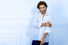 Dreamboat guy. Handsome sexy man wearing white shirt looking at camera. Men`s beauty, fashion model. Hair styling Stock Photos