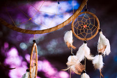 Dreamcatcher against a background of purple sunset dark. Background Royalty Free Stock Photography