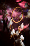 Dreamcatcher against a background of purple sunset dark. Background Royalty Free Stock Images