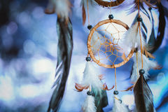 Dreamcatcher against a white blur of snow.  Royalty Free Stock Images