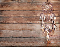 Dreamcatcher, american native amulet on wooden background. Shaman. Dreamcatcher, american native amulet on wooden background Stock Photo