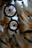 Dreamcatcher (close up). A dreamcatcher flowing in a light breeze. Feathers are showing the flowing movement Stock Image