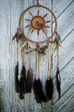 Dreamcatcher. Closeup on old wood texture Stock Images