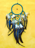 Dreamcatcher. Dream catcher on old yellow  wall Stock Photography