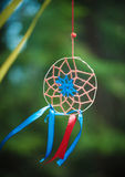 Dreamcatcher in the forest. Beautiful handmade dreamcatcher in the forest outdoor Royalty Free Stock Image