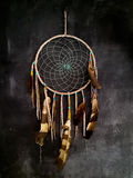 Dreamcatcher. Hanging on dark grey wall Stock Image