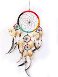 Dreamcatcher isolated in white. A red,green and black dreamcatcher isolated in white Stock Photo