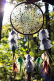 Dreamcatcher made of feathers, leather, beads, and ropes Royalty Free Stock Photo