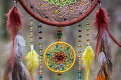 Dreamcatcher made of feathers, leather, beads, and ropes Royalty Free Stock Photography