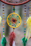 Dreamcatcher made of feathers, leather, beads, and ropes Royalty Free Stock Image