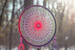 Dreamcatcher made of feathers, leather, beads, and ropes. Red black and purple Dreamcatcher with bat made of feathers leather beads and ropes, hanging stock image