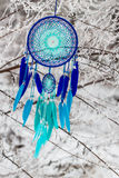 Dreamcatcher made of feathers, leather, beads, and ropes. Red black and purple Dreamcatcher with bat made of feathers leather beads and ropes, hanging Royalty Free Stock Photo