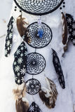 Dreamcatcher made of feathers, leather, beads, and ropes Royalty Free Stock Images