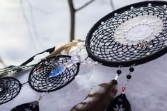 Dreamcatcher made of feathers, leather, beads, and ropes. Red black and purple Dreamcatcher with bat made of feathers leather beads and ropes, hanging Royalty Free Stock Photography