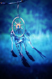 Dreamcatcher. And nature blue background Stock Photo