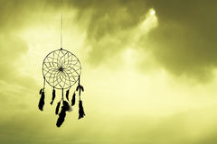 Dreamcatcher silhouette at sunset Stock Photos