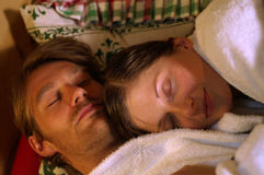 Dreamcouple. A couple dreams away in rustic bed Stock Image