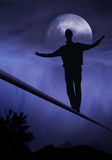 Dreamdancer. Tightrope walker, artist is walking on a tighttrope Stock Photos