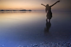 The dreamer. Girl on a beach at the end of summer Stock Photography